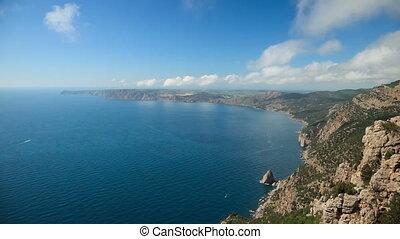 Sea coast view from high cliffs. Crimea. Russia