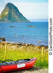 Sea coast with red canoe on shore Andoya Norway