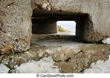 Sea coastline landscape through a window in a stone structure