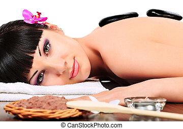 sea cosmetics - Beautiful woman relaxing in a spa salon....