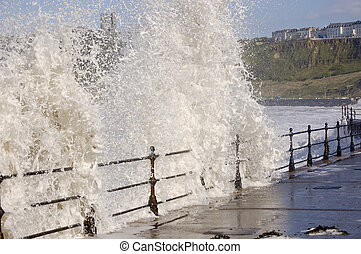 Sea crashing over railings at the North Bay Scarborough,...