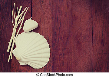 sea decoration on brown wooden background