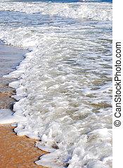 Sea foam and sand
