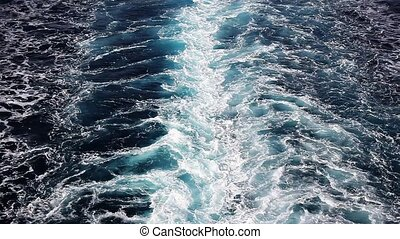 Sea foam behind a boat - Seawater with sea foam behind a...