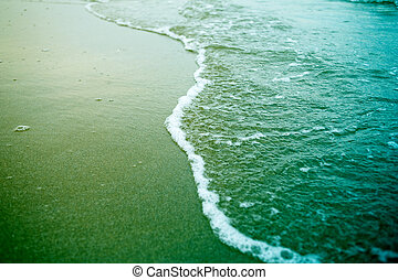sea foam on a beach