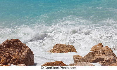 Sea foam on the shore, close up