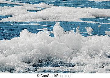 Sea foam - White foam on a sea water surface