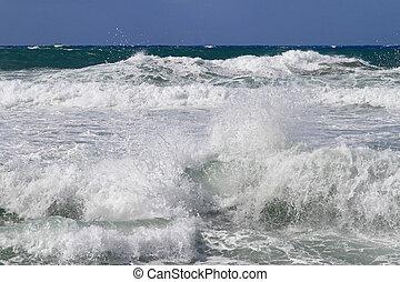 Sea foam and big waves at rough sea