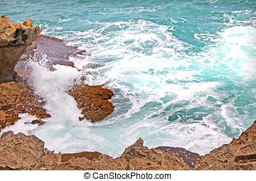 sea foam,rocks and turquoise sea water