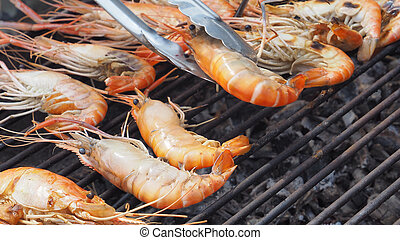 Sea food of shrimp grill cooking on charcoal strove
