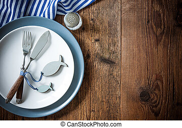 Sea food place setting on wooden table with copy space