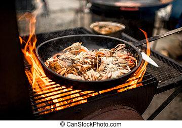 Sea food preparing on the fire