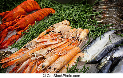 sea food table - fishes, scrims and lobsters on ice