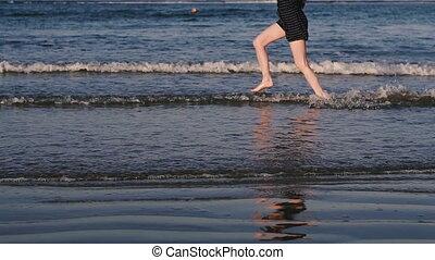 Sea. Girl runs along the sea