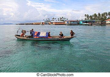 Sea gypsies in Mabul Island, Sabah
