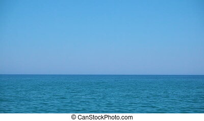 Sea horizon and clear blue sky