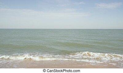 Sea horizon with a sandy beach