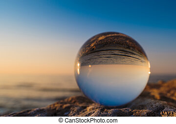 Sea in crystal ball - Coast reflected inside the crystal...
