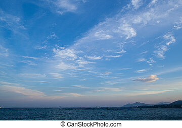 In good weather, bright skies, sea coast and mountains.