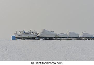sea in winter, yacht