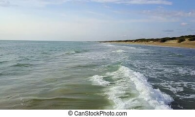 Sea is in contact with land on which is located the campers....