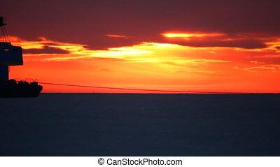 Sea landscape. - Sea sunset. Tugboat. Nautical derrick.