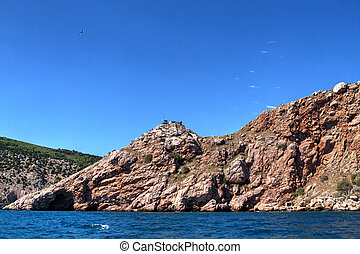 Sea landscape with rocks on shore