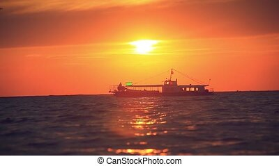 Sea Luxury Cruise Ship at sunset and splashes waves. Seagulls flying in the sky
