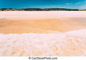 Sea Ocean Waves washing yellow sand at beach. Resort, holiday on sea. Vacation background.