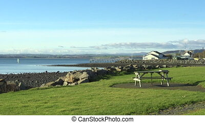 Strangford Lough from Newtownards, County Down, Northern Ireland, UK. View of landscape from picnic area with sea and windsurfer. Nature, sport and Irish travel destination