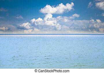Sea on a blue sky background