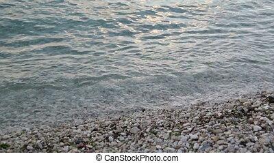 Sea pebble beach sunset - Sea pebble beach on a warm summer...