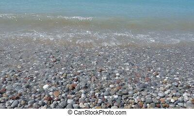 Sea. Pebble beach, waves - Sea. Pebble beach wavesfoam  rest