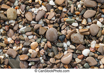 Sea pebble stones background beach rocks
