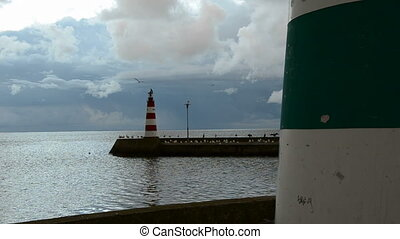 sea pier with two ligthouses