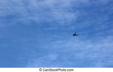 Sea Plane in Clouds