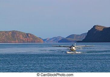 A sea plane lands on Talbot Bay