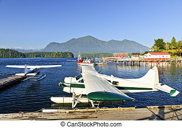Sea planes at dock in Tofino, Vancouver Island, Canada -...