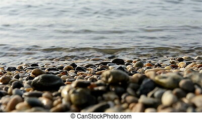 Sea polished rocks closeup photo