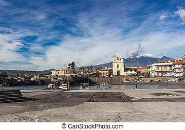 Sea port and houses in Sicily.