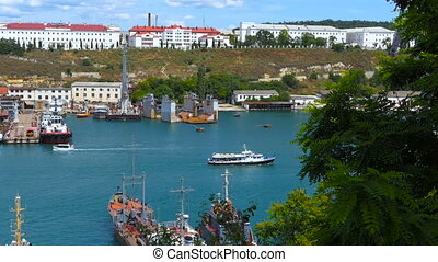 Sea port in the bay city - Movement and repair of ships in...