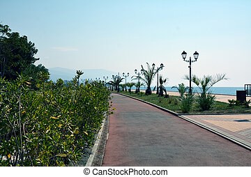 Sea promenade with the mountains in the far