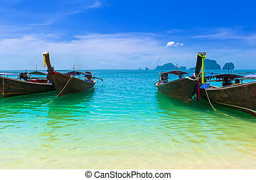 Sea resort Blue water, cloudy sky and traditional fishing boats Travel background