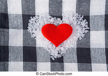 sea salt for food love heart on checkered towel background with space to copy text