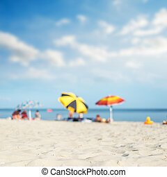 sea, sand and umbrellas under hot sun