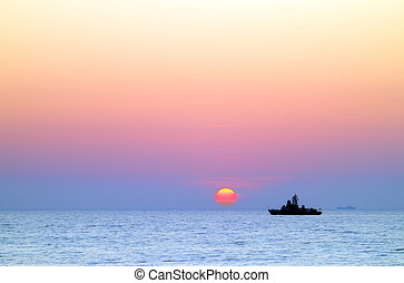 sea ship at sunset