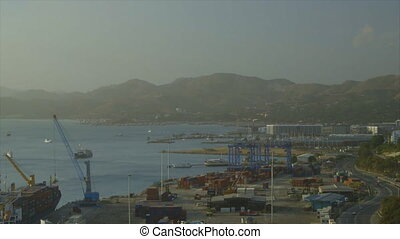 Sea shipment place - A wide steady shot of the cargo at a...