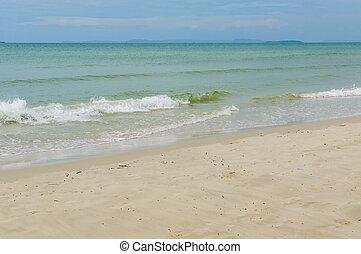 Sea waves on sand beach of Sihanoukville, Cambodia.