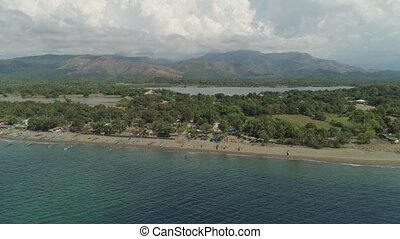 Sea shore with beach and hotel, Philippines,Luzon - Aerial...