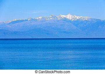 Sea, snow mountains, Peloponnese, Greece - Blue sea view and...
